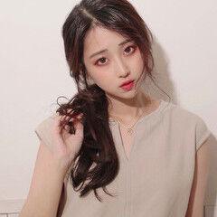 ローポニーテール 暗色カラー ポニーテール 韓国ヘア ヘアスタイルや髪型の写真・画像
