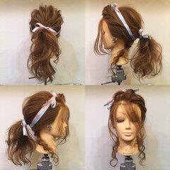 ロープ編み ポニーテール ヘアアレンジ 波ウェーブ ヘアスタイルや髪型の写真・画像