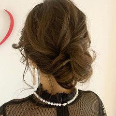 フェミニン ミディアム シニヨン ヘアスタイルや髪型の写真・画像