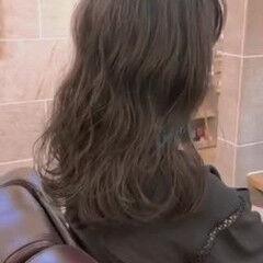 コテ巻き風パーマ セミロング 韓国風ヘアー ゆるふわパーマ ヘアスタイルや髪型の写真・画像