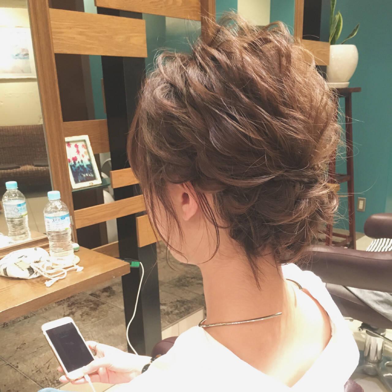 結婚式 波ウェーブ シニヨン ヘアアレンジヘアスタイルや髪型の写真・画像