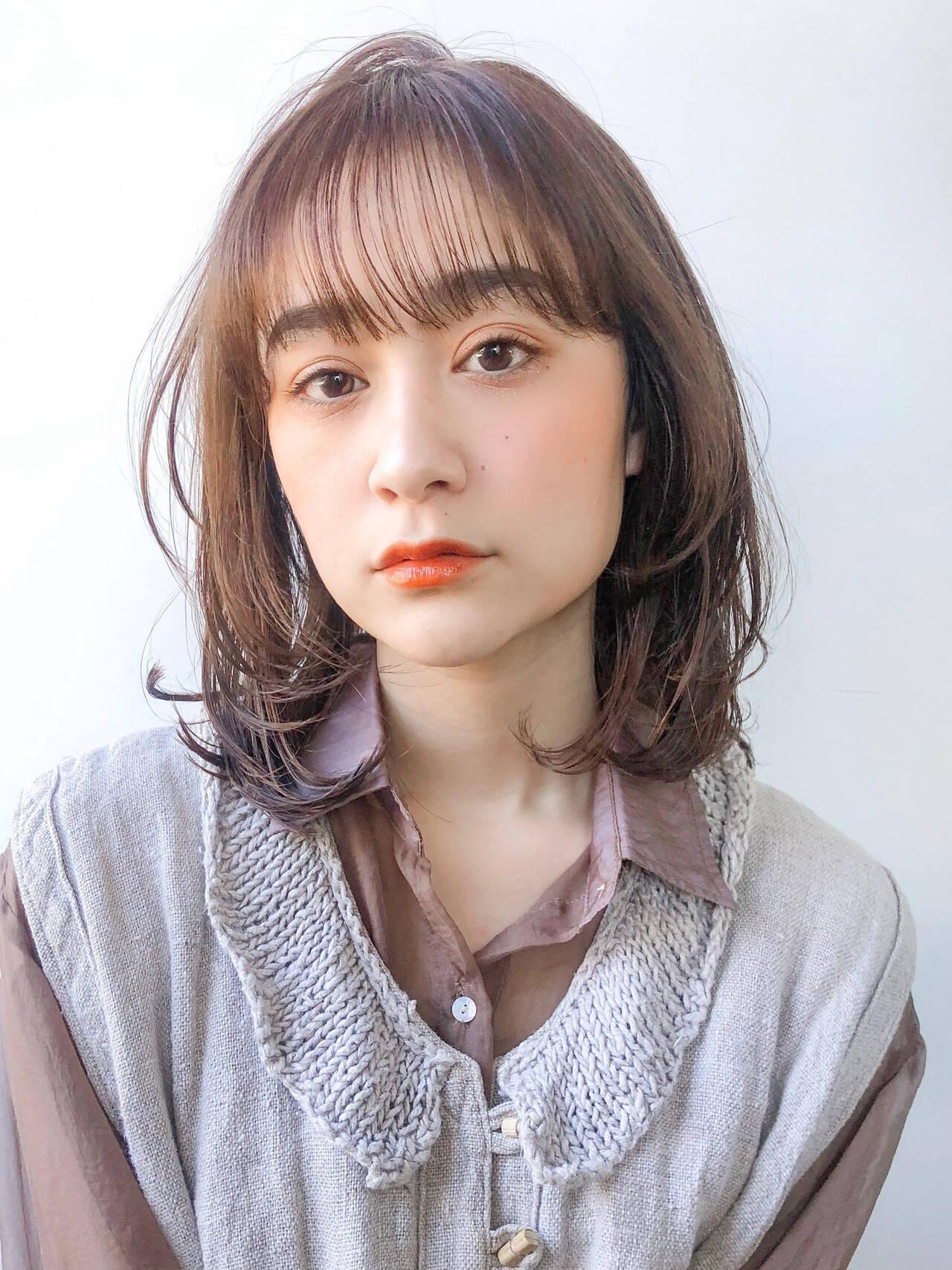 ウルフカット レイヤーカット ゆるふわパーマ ナチュラルヘアスタイルや髪型の写真・画像