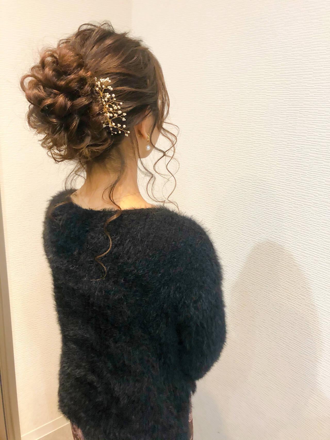 ブライダル アップスタイル 結婚式 フェミニンヘアスタイルや髪型の写真・画像