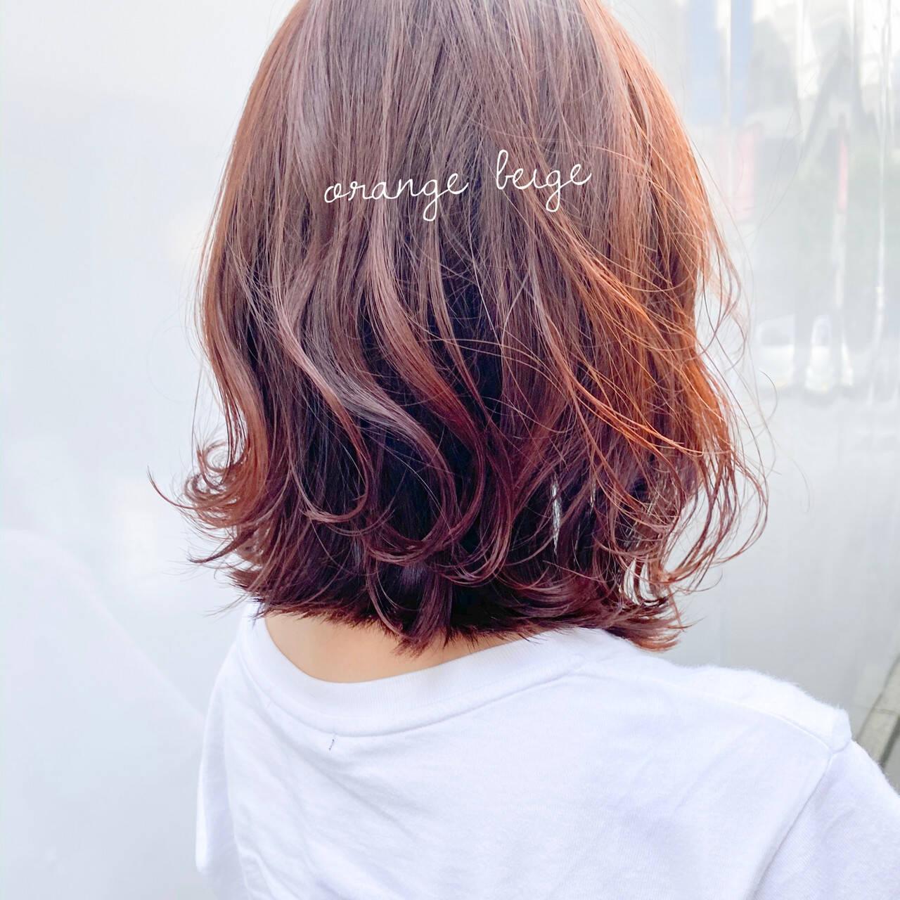 インナーカラーオレンジ オレンジカラー オレンジベージュ アプリコットオレンジヘアスタイルや髪型の写真・画像
